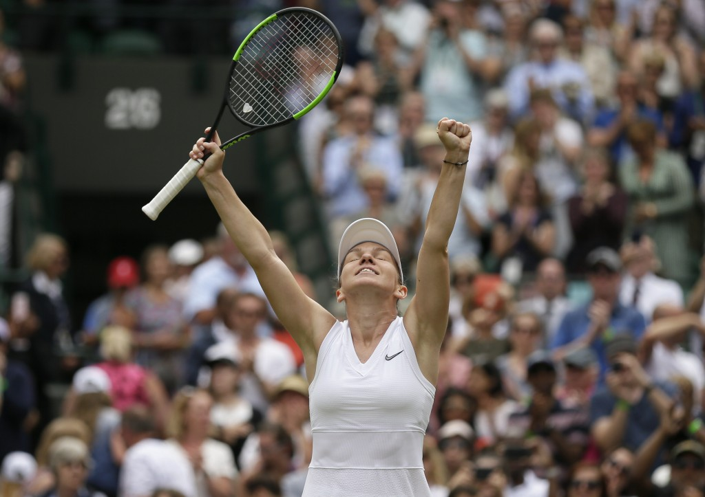 Romania's Simona Halep celebrates defeating China's Shuai Zhang in a women's quarterfinal match on day eight of the Wimbledon Tennis Championships in ...