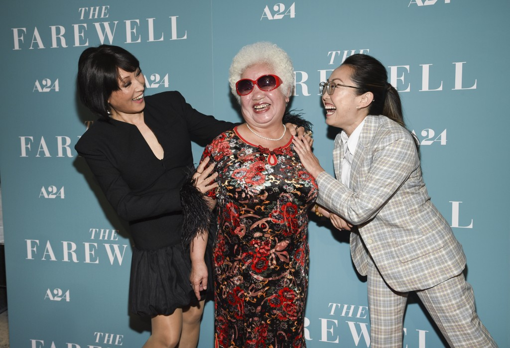 """Actors Diana Lin, left, Hong Lu and writer-director Lulu Wang pose together at a special screening of """"The Farewell"""" at Metrograph on Monday, July 8,"""