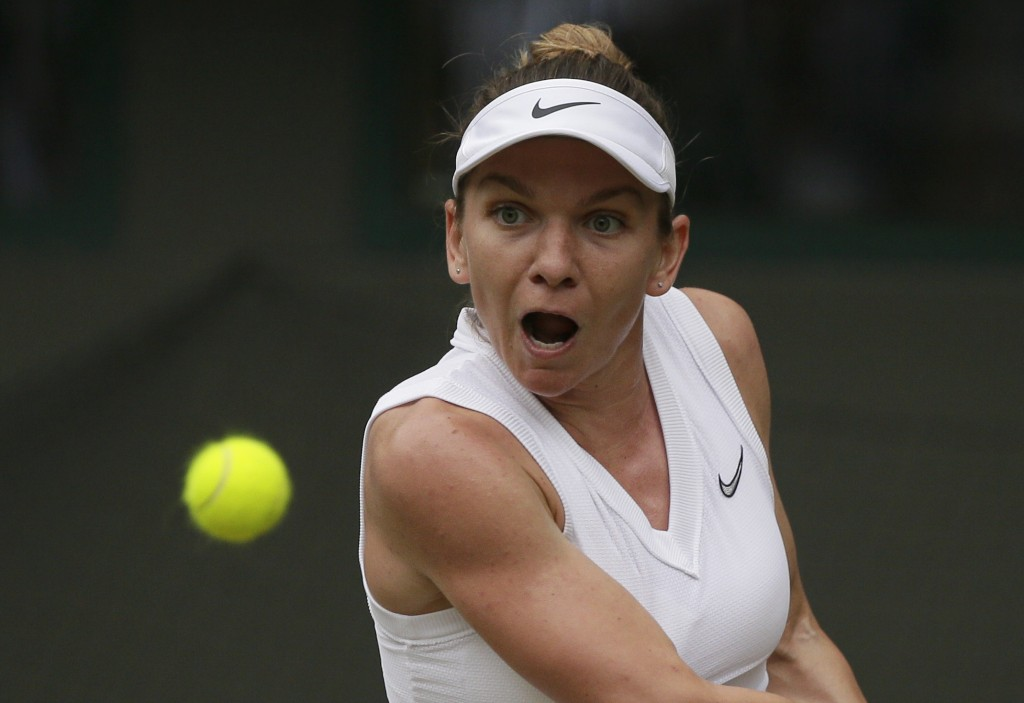 Romania's Simona Halep returns the ball to China's...