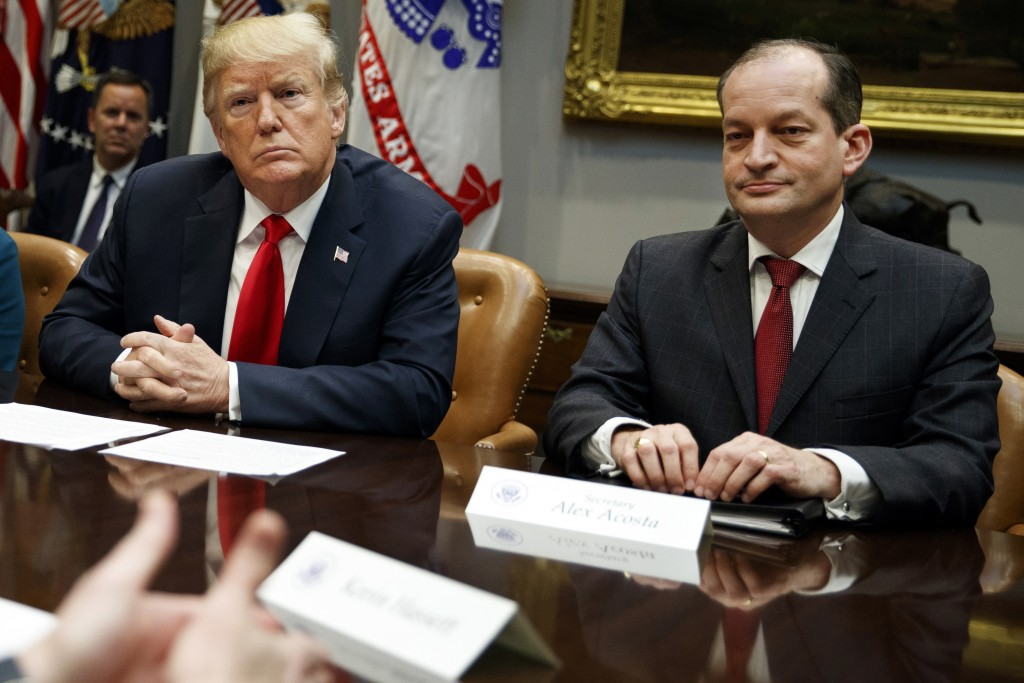 FILE - In this Sept. 17, 2018, file photo, President Donald Trump, left, and Labor Secretary Alexander Acosta listen during a meeting of the President