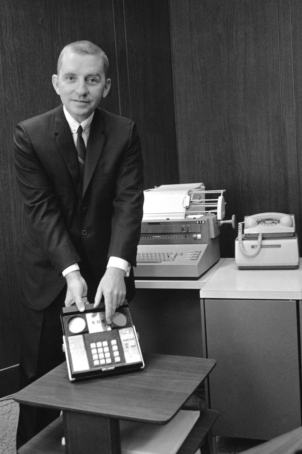 FILE - In this Oct. 31, 1968, file photo H. Ross Perot, head of Electronic Data Systems Corp., of Dallas, holds a piece of electronic computer equipme...