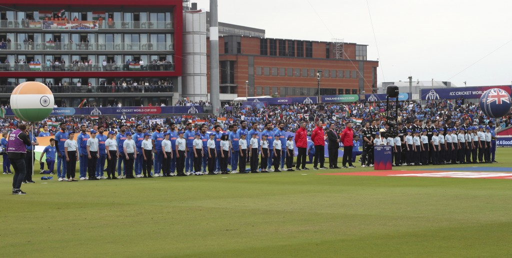 India and New Zealand players stand for their national anthems before the start of the Cricket World Cup semi-final match between India and New Zealan