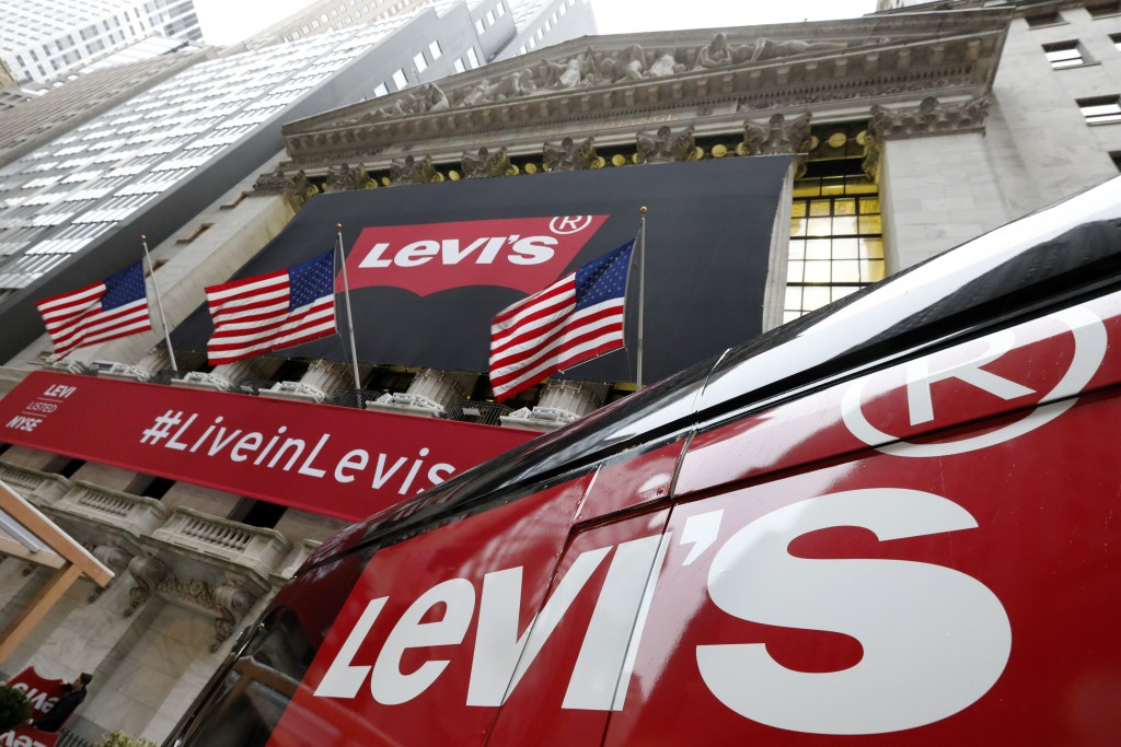 FILE- In this March 21, 2019, file photo a Levi's banner adorns the facade of the New York Stock Exchange. Levi Strauss & Co. reports financial result