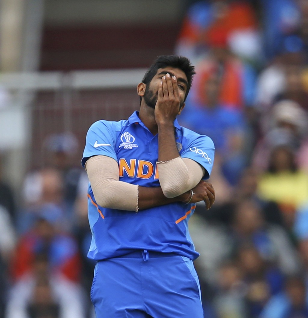 India's Jasprit Bumrah reacts after a drop catch by teammate Mahendra Singh Dhoni during the Cricket World Cup semifinal match between India and New Z