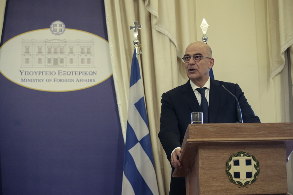 Greek Foreign Minister Nikos Dendias, speaks at the Foreign Ministry in Athens, during a handover ceremony, on Tuesday, July 9, 2019. Greece's new Cab