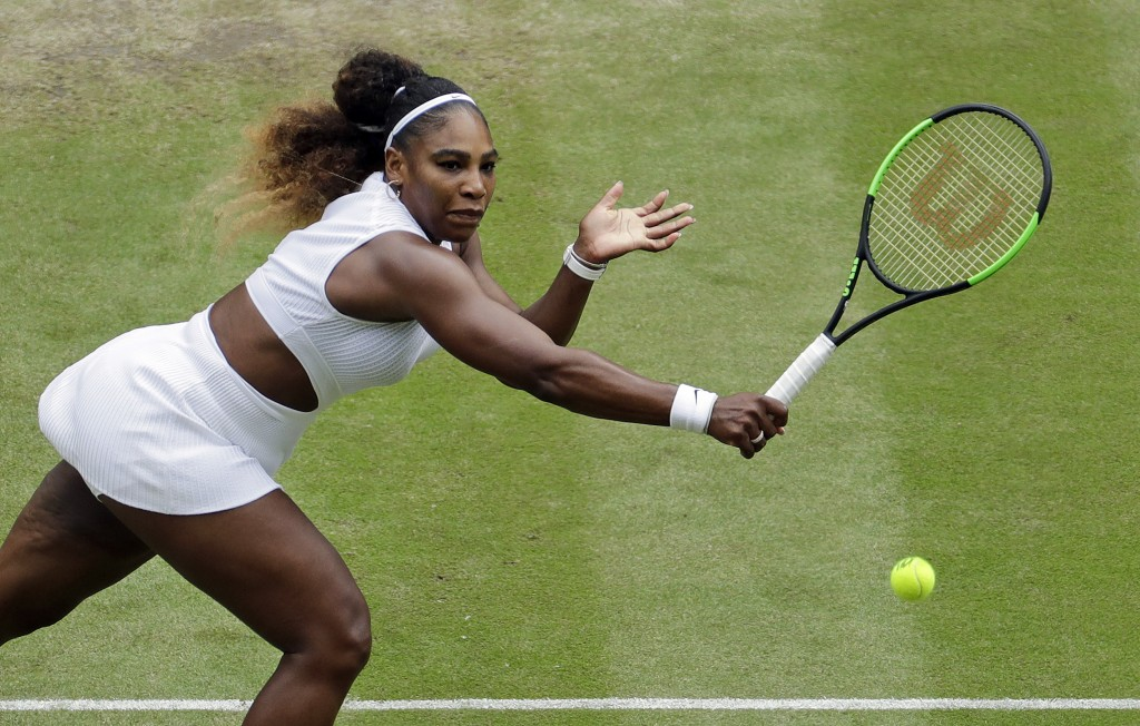 United States' Serena Williams returns to United States' Alison Riske in a Women's quarterfinal singles match on day eight of the Wimbledon Tennis Cha...