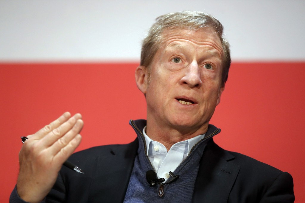 """FILE- In this March 16, 2018, file photo political activist Tom Steyer speaks during a """"Need to Impeach"""" town hall event at the Clifton Cultural Arts"""