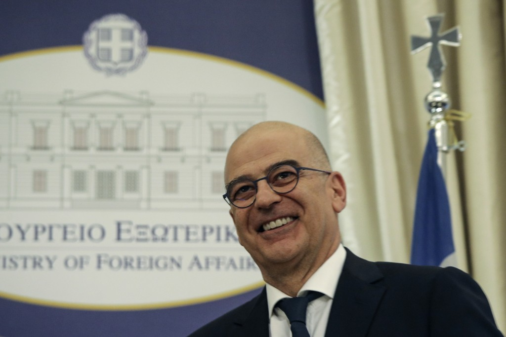 Greek Foreign Minister Nikos Dendias, smiles at the Foreign Ministry in Athens, during a handover ceremony, Tuesday, July 9, 2019. Greece's new Cabine