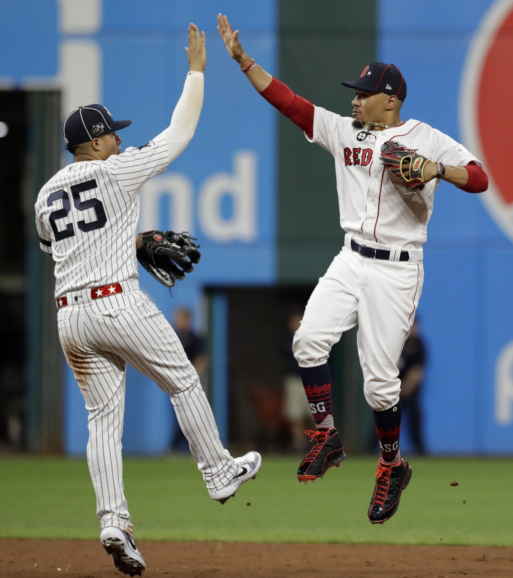 American League Gleyber Torres, left, of the New York Yankees, and American League Mookie Betts, of the Boston Red Sox, celebrate a 4-3 victory of the