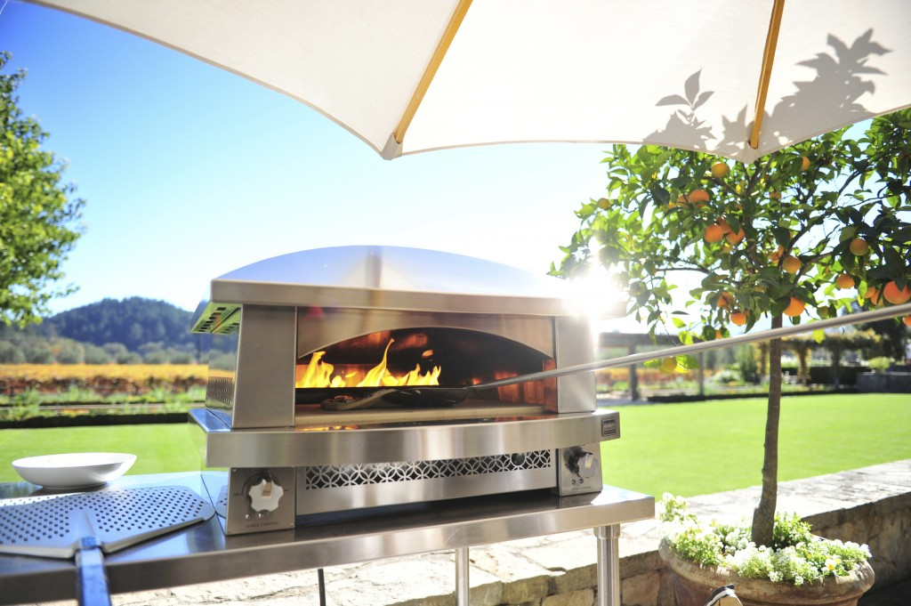 This photo provided by Kalamazoo Outdoor Gourmet shows one of the company's Artisan gas-fired pizza oven at a home in Napa, Calif. Along with a good g