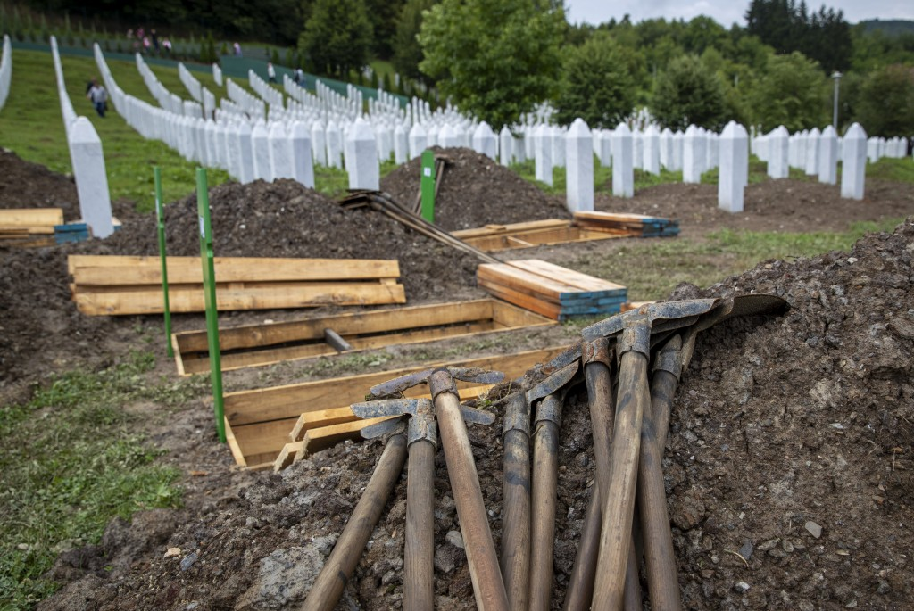 Fresh graves are dug at the memorial cemetery in Potocari near Srebrenica, Bosnia, Wednesday, July 10, 2019. The remains of 33 victims of Srebrenica m