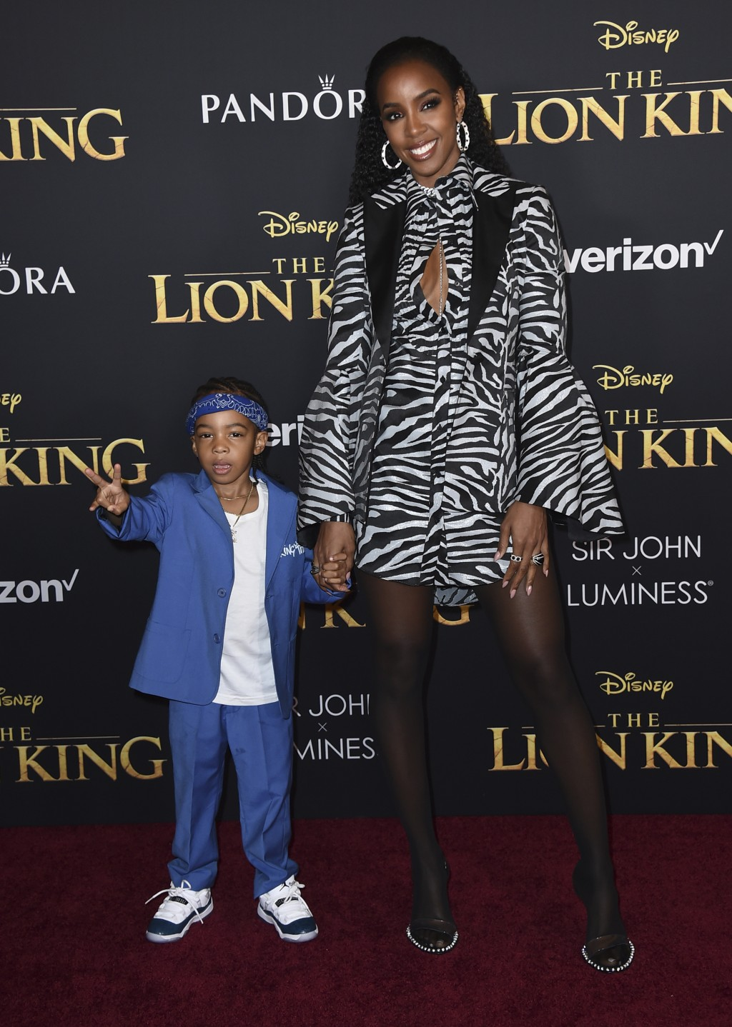 """Kelly Rowland and her son Titan arrive at the world premiere of """"The Lion King"""" on Tuesday, July 9, 2019, at the Dolby Theatre in Los Angeles. (Photo"""