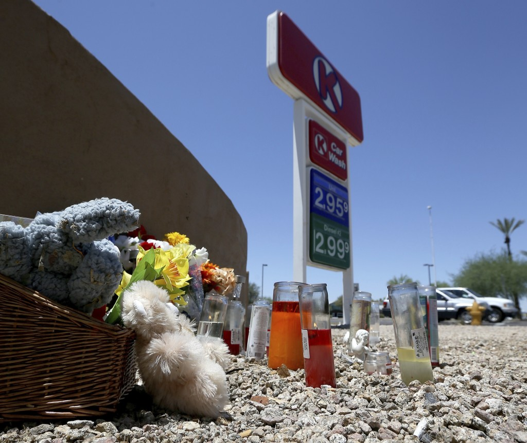 A makeshift memorial for Elijah Al-Amin is set up at a local Circle K store for the death of the stabbing victim Tuesday, July 9, 2019, in Peoria, Ari...