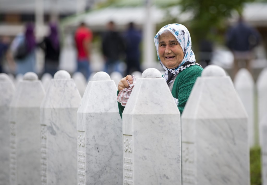 A woman cries at the memorial cemetery in Potocari, near Srebrenica, Bosnia, Wednesday, July 10, 2019. The remains of 33 victims of Srebrenica massacr...