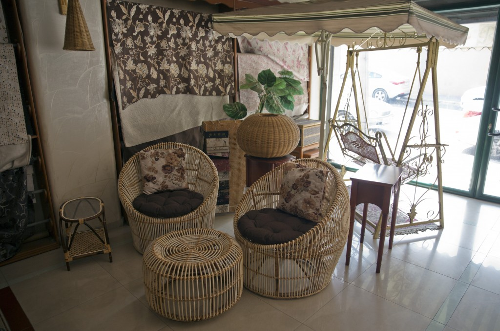 In this Saturday, July 6, 2019 photo, furniture for sale is displayed at a bamboo workshop in Gaza City.Talk about old Gaza, and what pops up are imag