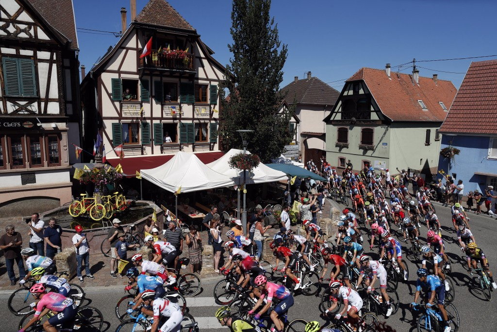 The pack rides during the fifth stage of the Tour de France cycling race over 175.5 kilometers (109 miles) with start in Saint-Die-Des-Vosges and fini...