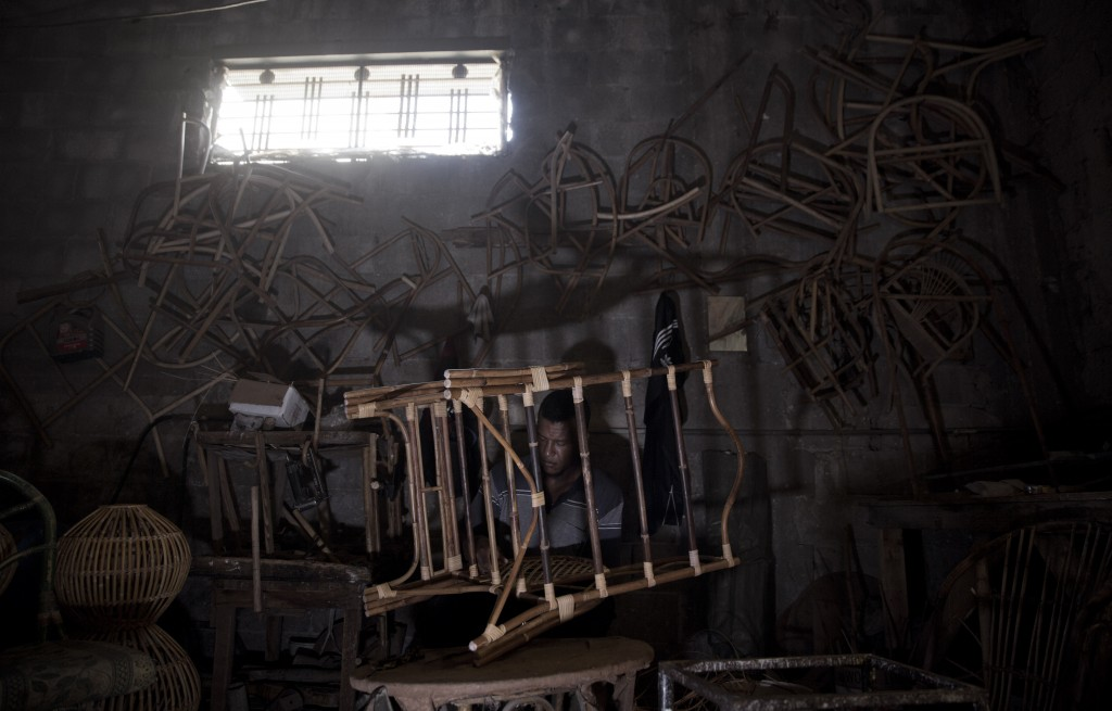 In this Saturday, July 6, 2019 photo, a Palestinian works at a bamboo workshop in Gaza City. Talk about old Gaza, and what pops up are images of clay