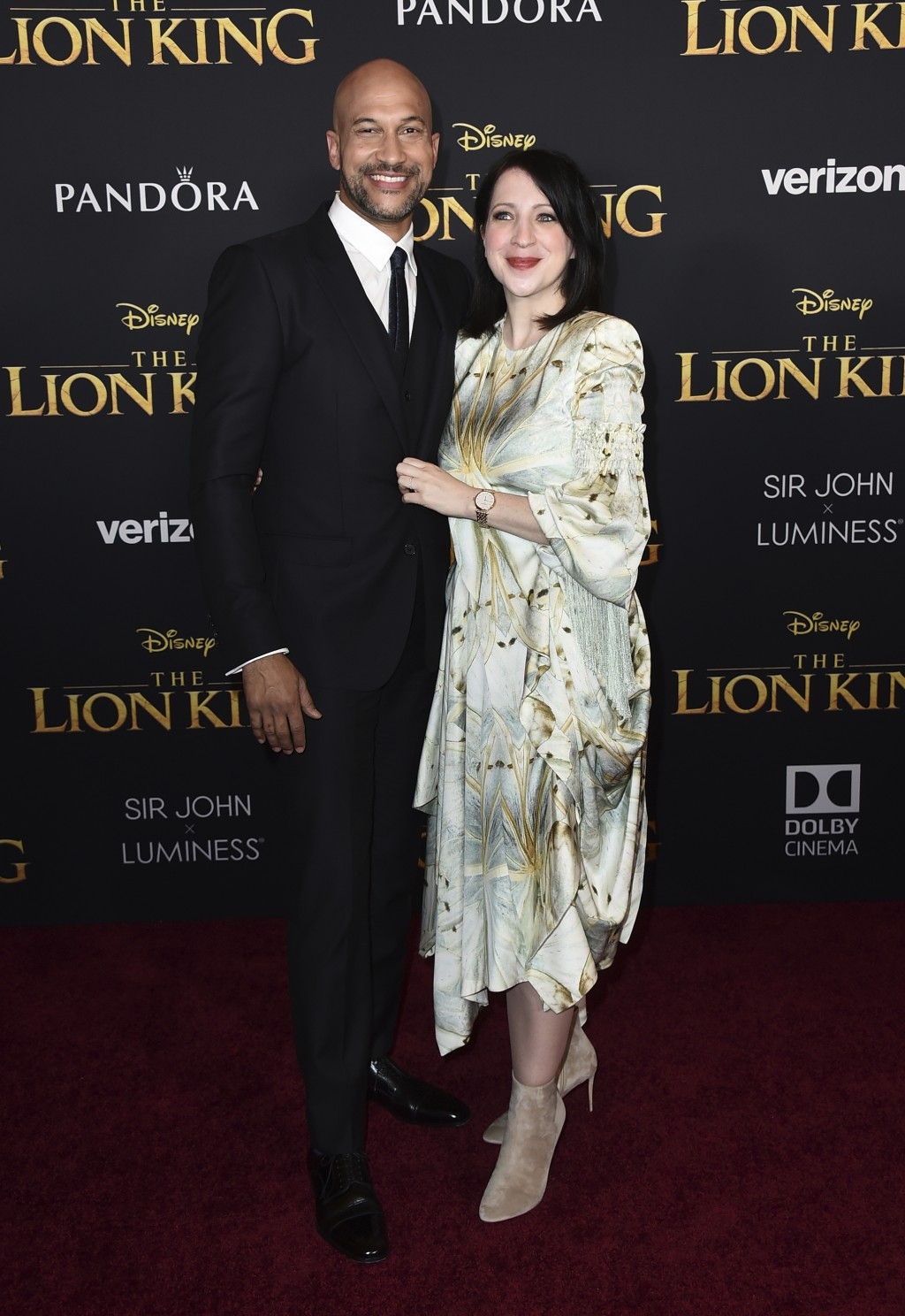 """Keegan-Michael Key, left, and Elisa Pugliese arrive at the world premiere of """"The Lion King"""" on Tuesday, July 9, 2019, at the Dolby Theatre in Los Ang"""