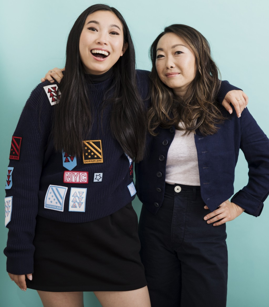 """This June 12, 2019 photo shows filmmaker Lulu Wang, right, and actress Awkwafina posing in New York to promote their film, """"The Farewell."""" (Photo by B..."""