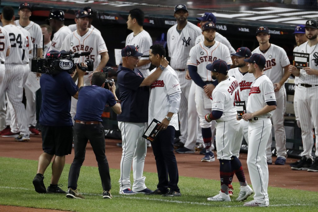 Cleveland Indians manager Terry Francona, left, hugs Indians pitcher Carlos Carrasco during the middle of the fifth inning of the MLB baseball All-Sta