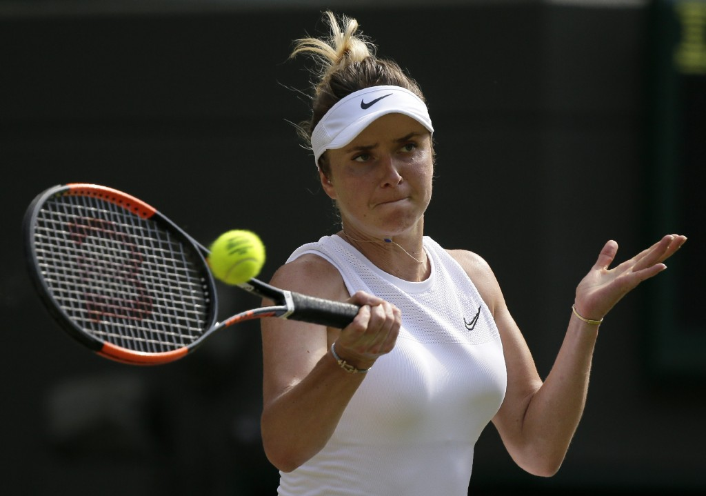 Ukraine's Elina Svitolina returns the ball to Czech Republic's Karolina Muchova during a women's quarterfinal match on day eight of the Wimbledon Tenn...