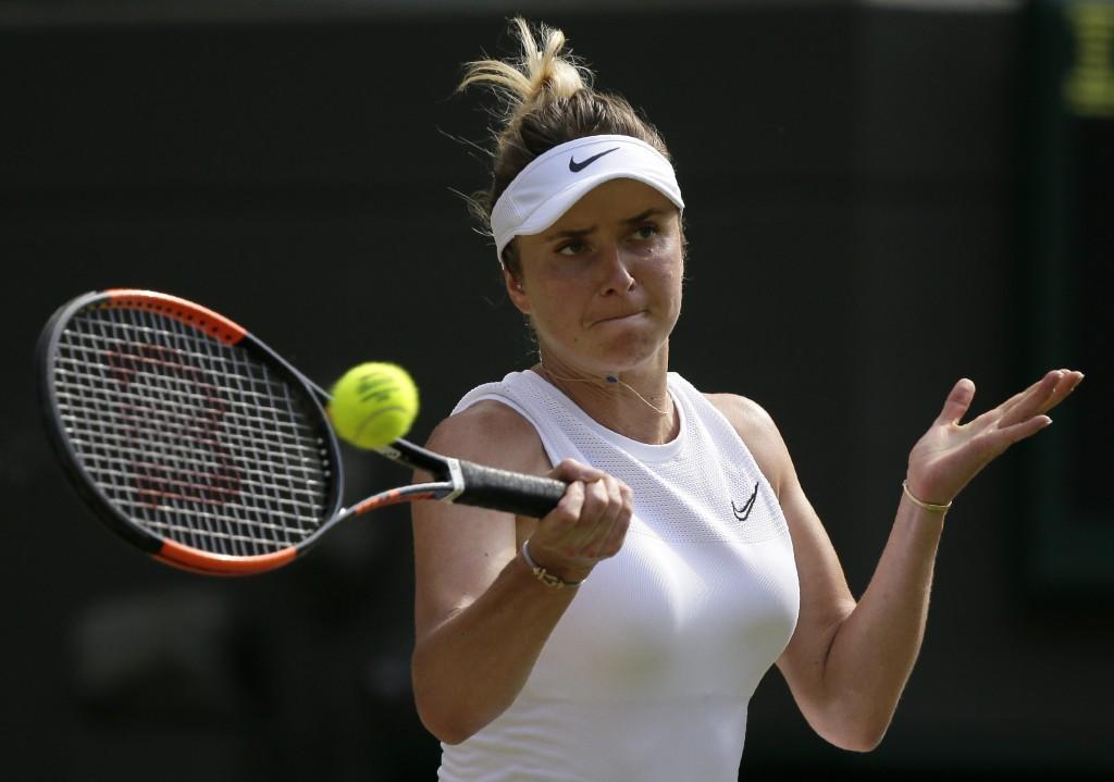 Ukraine's Elina Svitolina returns the ball to Czech Republic's Karolina Muchova during a women's quarterfinal match on day eight of the Wimbledon Tenn
