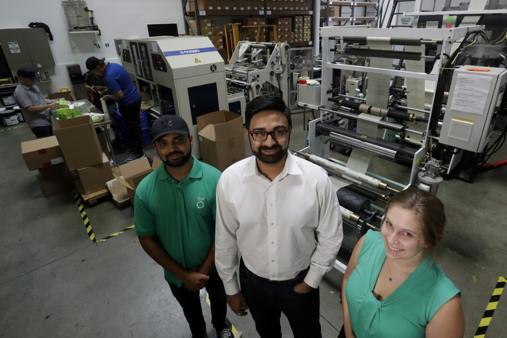 In this Friday, July 5, 2019, file photo Achyut Patel, Director of Operations, Rudy Patel, Director of Business Development an Katrina Hart, business ...