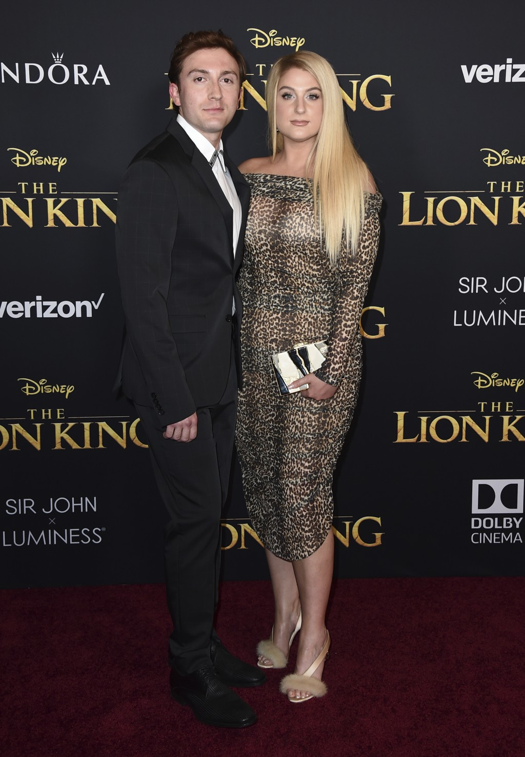 """Meghan Trainor, right, and Daryl Sabara arrive at the world premiere of """"The Lion King"""" on Tuesday, July 9, 2019, at the Dolby Theatre in Los Angeles."""