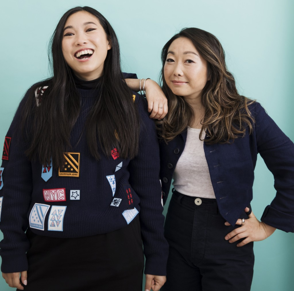 """This June 12, 2019 photo shows filmmaker Lulu Wang, right, and actress Awkwafina posing in New York to promote their film, """"The Farewell."""" (Photo by B"""