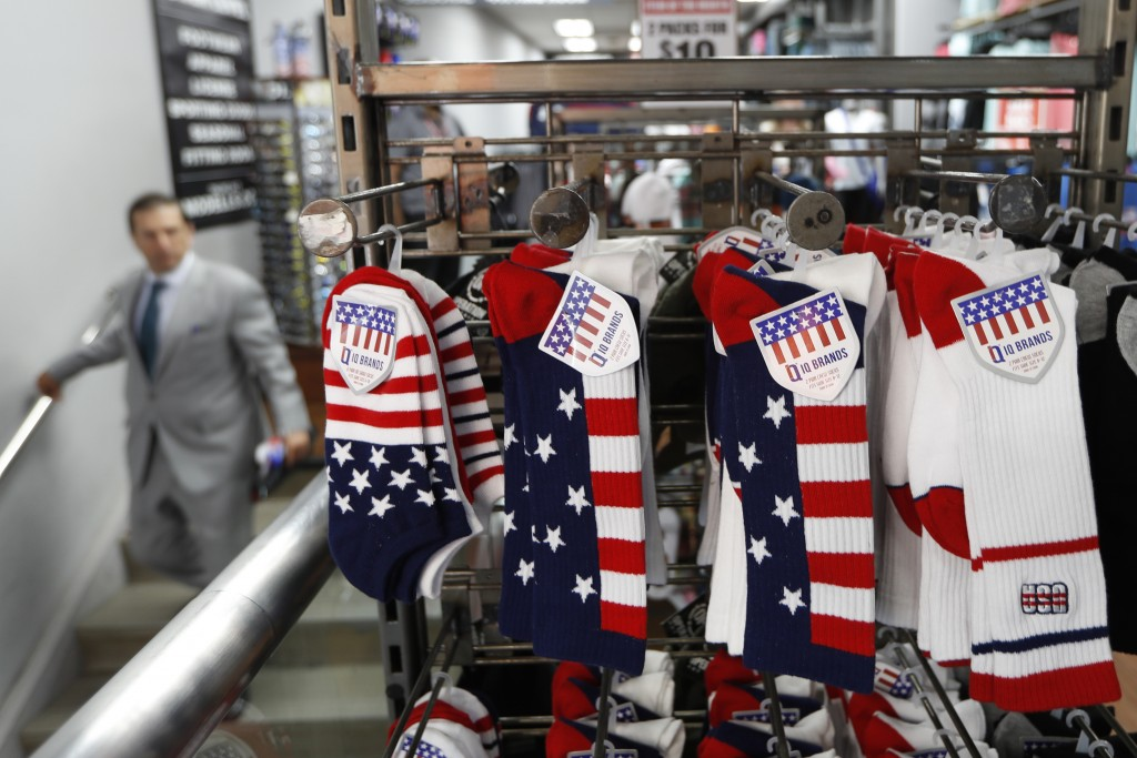 Red, white and blue socks are prominently displayed in an athletic clothing store one day ahead of a ticker-tape parade for the U.S. Women's Soccer Wo