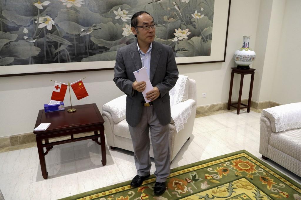 In this April 9, 2019, photo, China's ambassador to Tonga, Wang Baodong, waits to speak to The Associated Press at the embassy in Nuku'alofa, Tonga. C