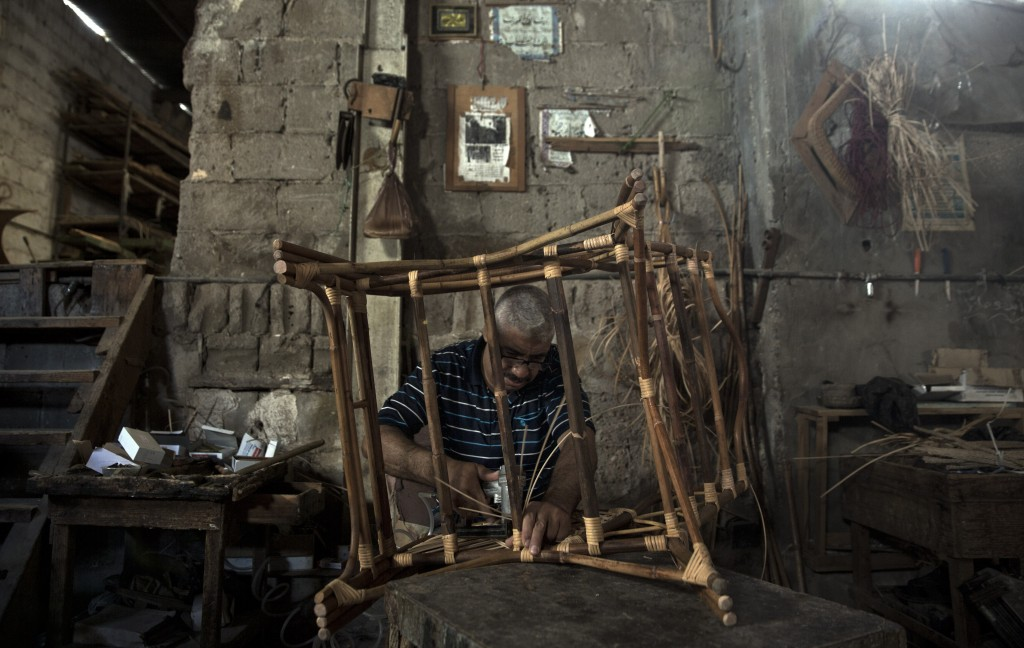 In this Saturday, July 6, 2019 photo, a Palestinian works at a bamboo workshop in Gaza City. Talk about old Gaza, and what pops up are images of clay ...