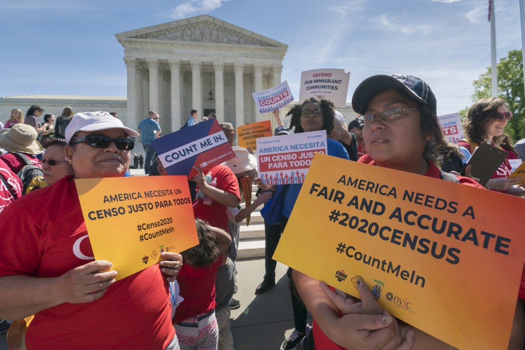 FILE - In this April 23, 2019 file photo, immigration activists rally outside the Supreme Court as the justices hear arguments over the Trump administ