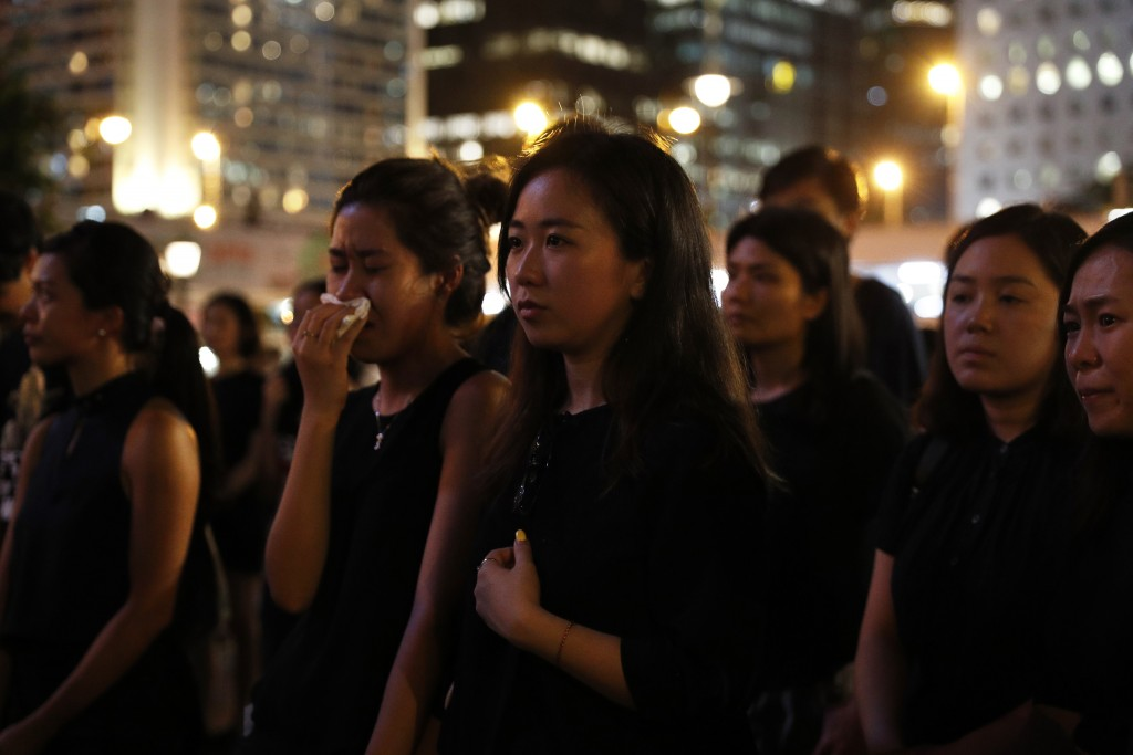 Attendees take part in a candle light vigil for the fourth apparent suicide related to the protests against an extradition law to China in Hong Kong o