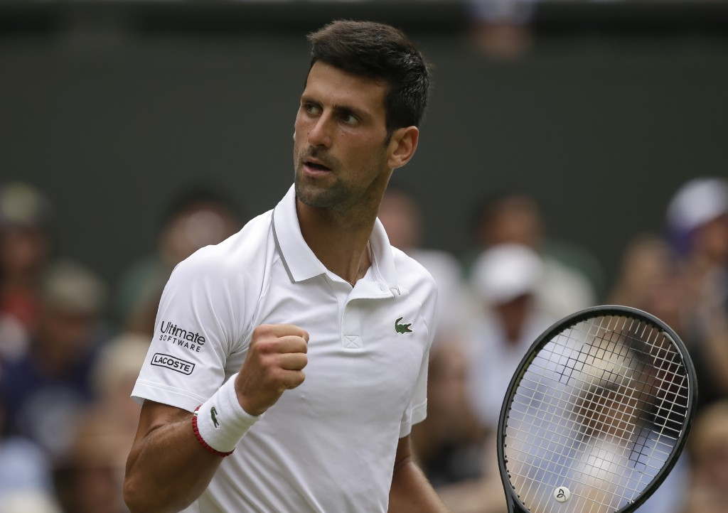 Serbia's Novak Djokovic celebrates winning the second set against Belgium's David Goffin during a men's quarterfinal match on day nine of the Wimbledo