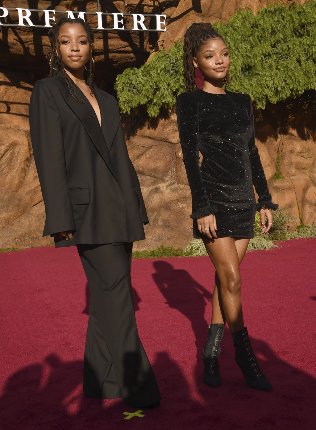 """Chloe Bailey, left, and Halle Bailey, of Chloe X Halle, arrive at the world premiere of """"The Lion King"""" on Tuesday, July 9, 2019, at the Dolby Theatre"""