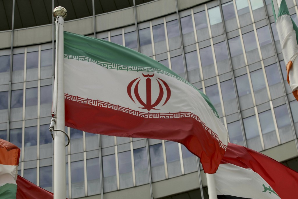 The Iranian flag waves outside of the UN building that hosts the International Atomic Energy Agency, IAEA, office inside in Vienna, Austria, Wednesday...