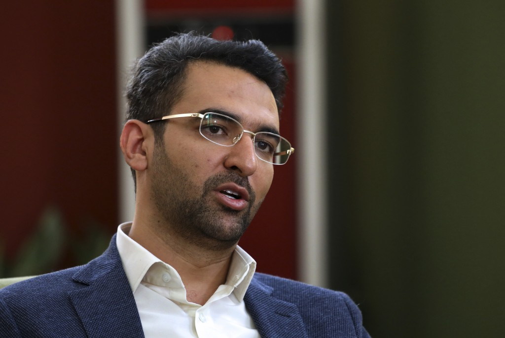 In this Sunday, July 7, 2019, photo, Iran's telecommunications Minister Mohammad Javad Azari Jahromi is interviewed by The Associated Press at his off...