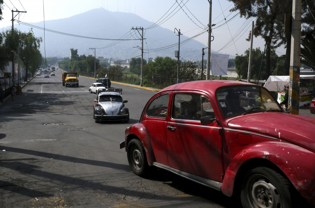 "Drivers commute in their Volkswagen Beetles in a neighborhood of Mexico City known colloquially as ""Vocholandia,"" for its love of the classic Beetle,"