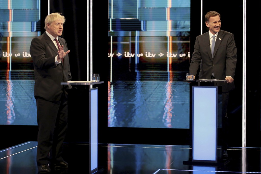In this photo issued by ITV, showing Britain's Conservative Party leadership candidates Boris Johnson, left, and Jeremy Hunt, during a live head-to-he