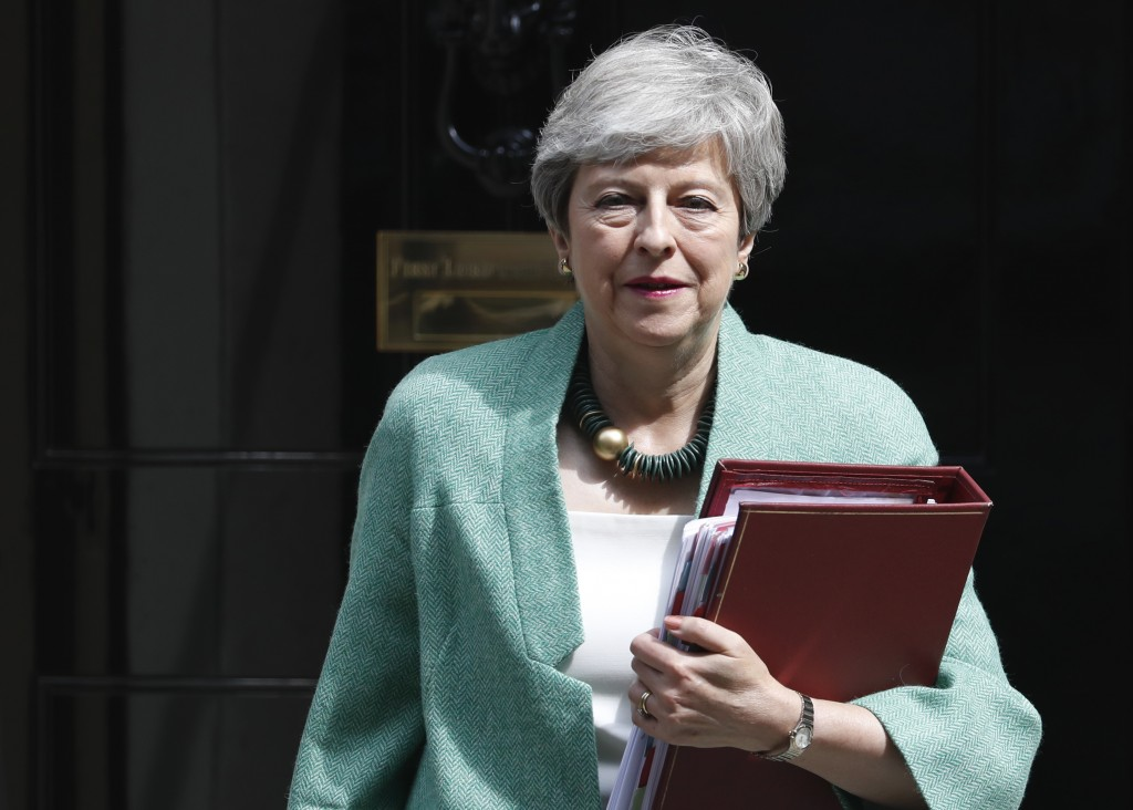 Britain's Prime Minister Theresa May leaves 10 Dow...