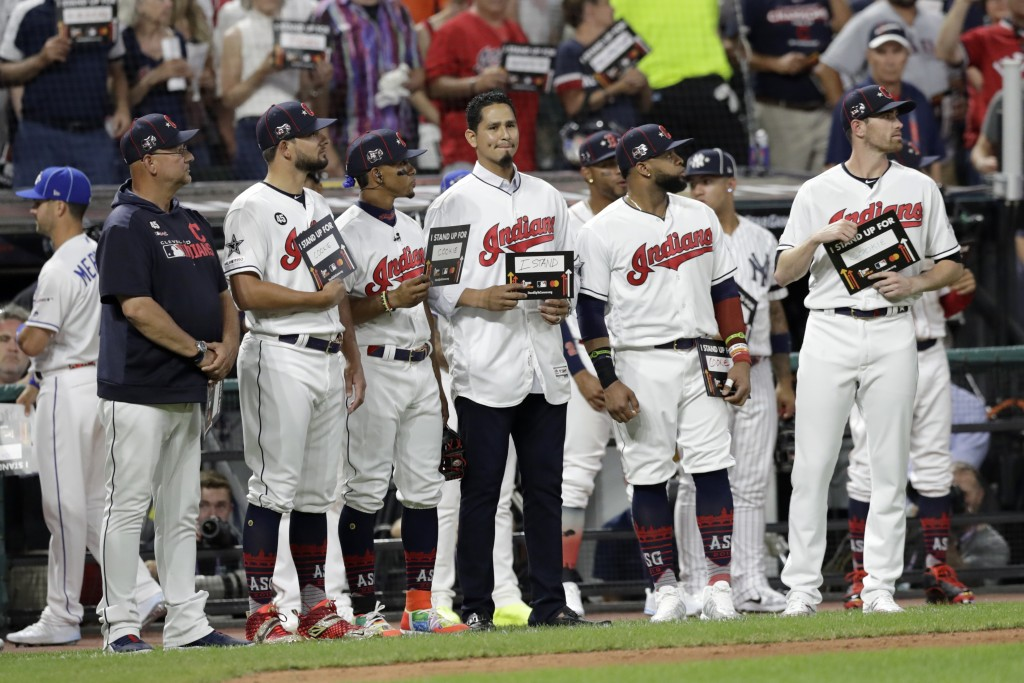 Cleveland Indians pitcher Carlos Carrasco, stands with Indians teammates during the fifth inning of the MLB baseball All-Star Game, Tuesday, July 9, 2