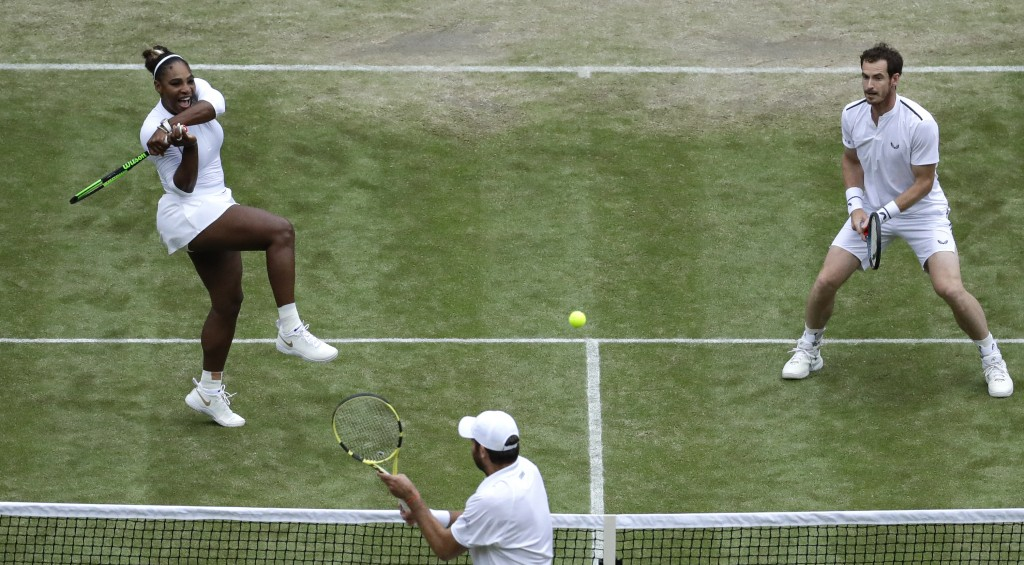 United States' Serena Williams and playing partner Britain's Andy Murray, top, in action against Fabrice Martin of France and Raquel Atawo of the Unit...