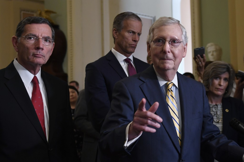Senate Majority Leader Mitch McConnell of Ky., second from right, speaks to reporters following the weekly policy luncheon on Capitol Hill in Washingt...