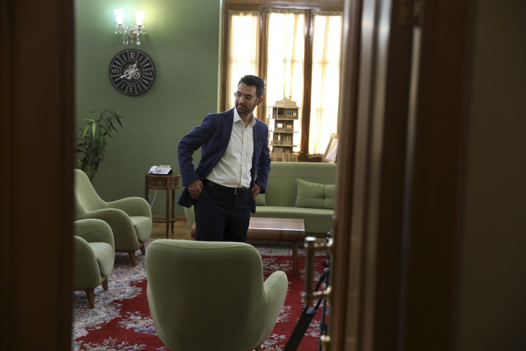 In this Sunday, July 7, 2019, photo, Iran's telecommunications Minister Mohammad Javad Azari Jahromi stands at his office after an interview with The ...