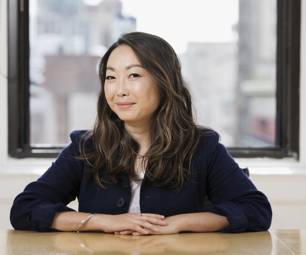 """This June 12, 2019 photo shows filmmaker Lulu Wang posing in New York to promote her film, """"The Farewell."""" (Photo by Brian Ach/Invision/AP)"""