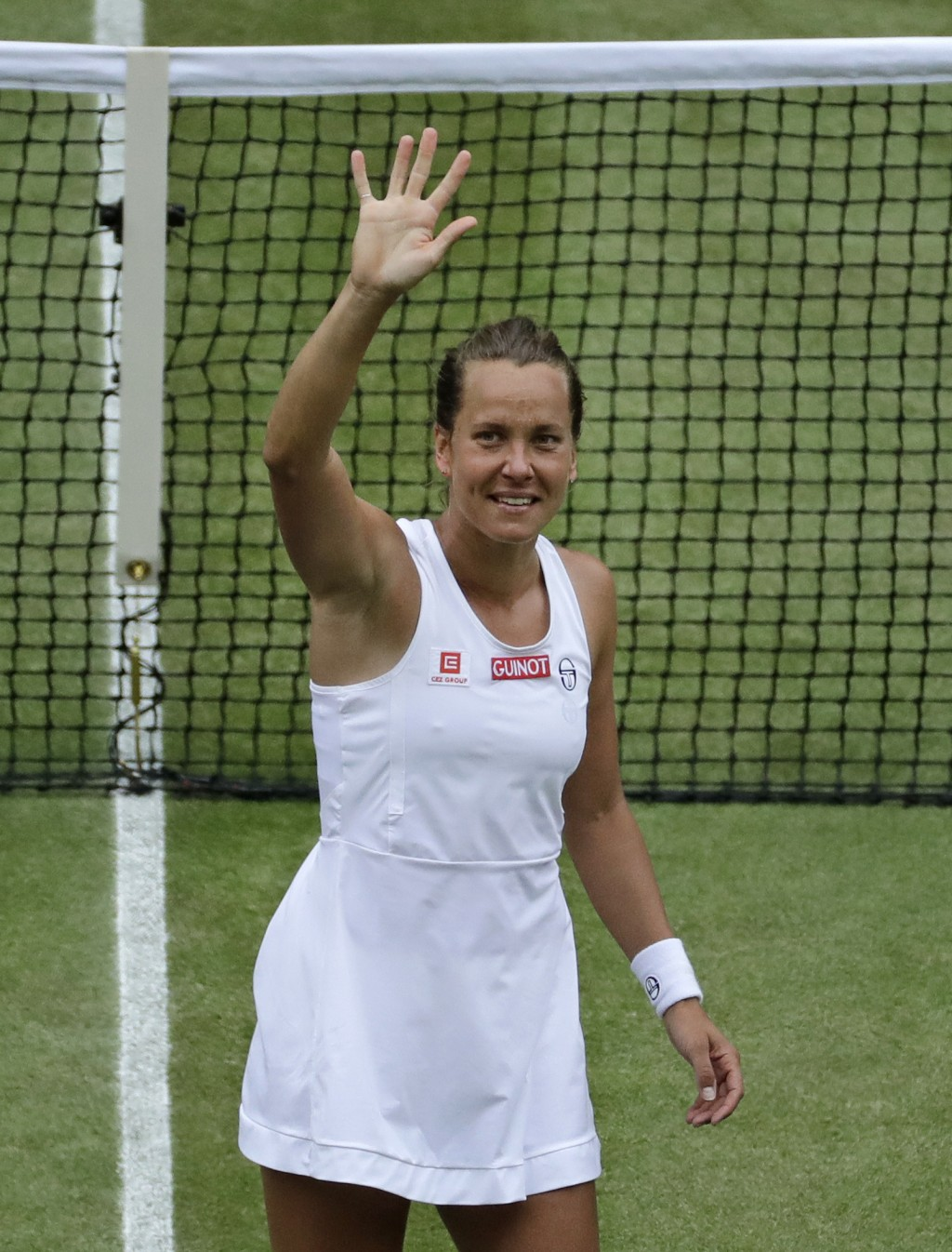 Czech Republic's Barbora Strycova celebrates after beating Britain's Johanna Konta in a Women's quarterfinal singles match on day eight of the Wimbled...