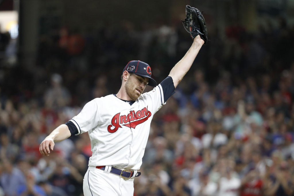 American League pitcher Shane Bieber, of the Cleveland Indians, reacts after striking out National League's Ronald Acuna Jr., of the Atlanta Braves, t