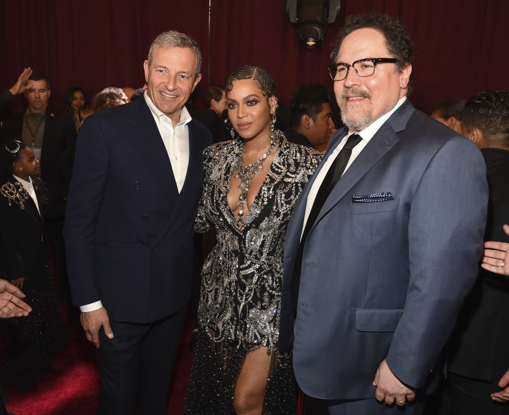 """Bob Iger, left, chairman and CEO of The Walt Disney Company, poses with """"The Lion King"""" cast member Beyonce, center, and the film's director Jon Favre"""