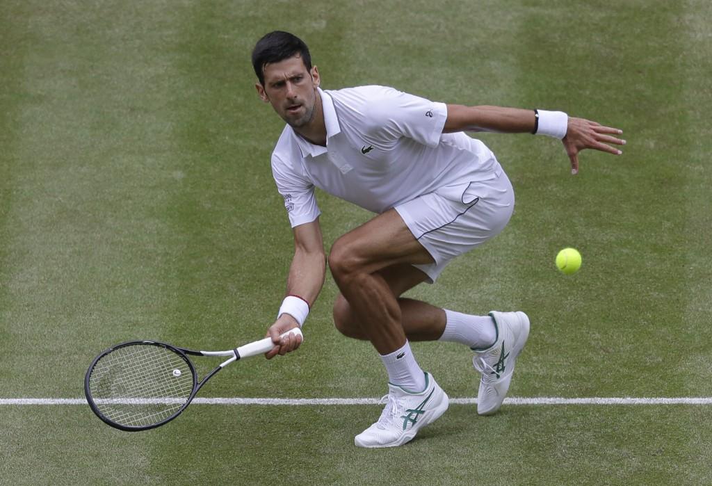 Serbia's Novak Djokovic returns the ball to Belgiu...